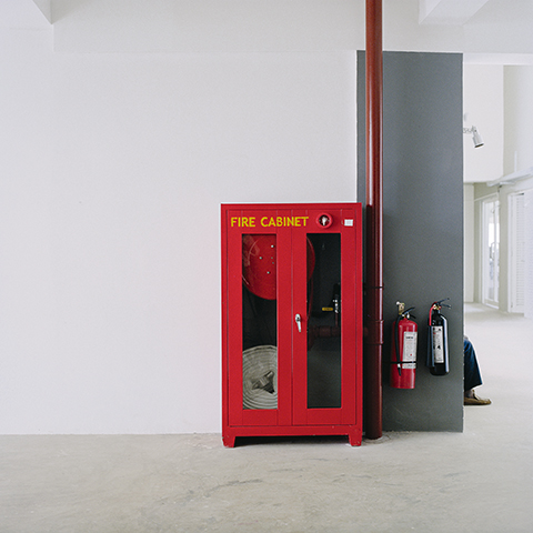 Kerstin Hamilton: Feet and fire cabinet.